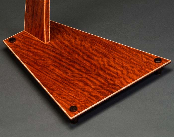 SM guitar stand base in bubinga with curly maple edge binding.