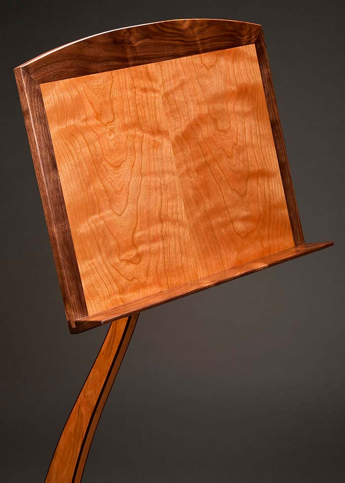 Cherry music holder with walnut edge binding and trim.