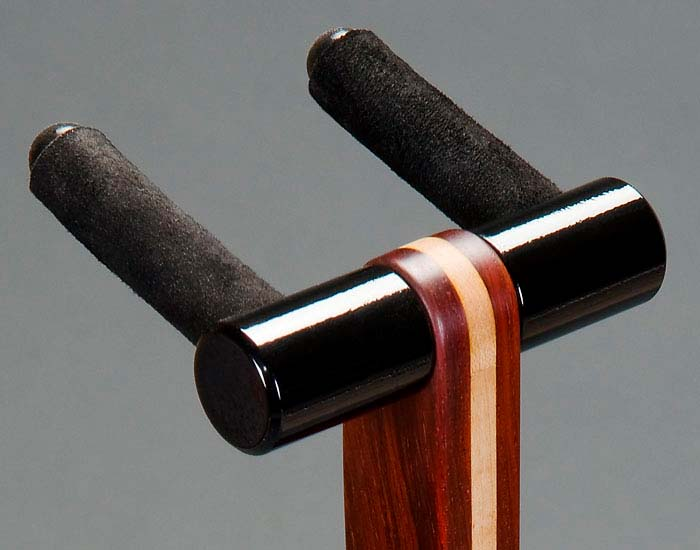 Mirror black powdercoated aluminum top parts on cocobolo.